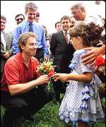 [ image: Tony Blair, seen meeting refugees in Albania, says brigade of Serb forces has been destroyed]