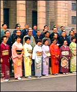 [ image: Politicans line up in their best kimonos]