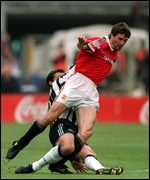 [ image: Roy Keane picks up his injury from a Gary Speed challenge]