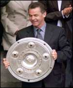 [ image: Bayern boss Ottmar Hitzfeld holds the German championship shield]