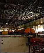 [ image: The dark turbine hall for the now-closed units 1 & 2]