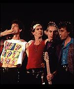 [ image: Bill Wyman (far right) on stage with the Rolling Stones in 1990]