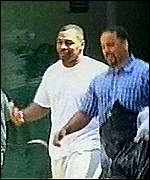 [ image: Tyson [left] leaves jail with a friend]