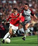 [ image: Bayern's Jens Jeremies challenges Ryan Giggs]
