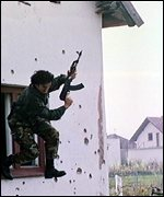 [ image: Troops practised dawn raids in pretend Balkan villages]