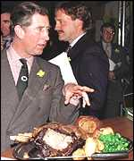 [ image: Prince Charles eating beef-on-the-bone at a recent Welsh reception]