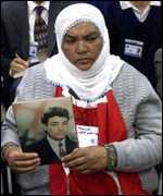 [ image: A Turkish woman holds a picture of her son, killed by the PKK]
