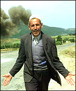 [ image: Evacuated: An Albanian man forced to leave his village]