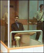 [ image: Mr Ocalan's testimony is given from behind a bomb- and bullet-proof cage]