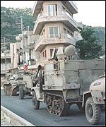 [ image: A convoy of around 30 military vehicles left the town on Wednesday night]