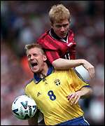 [ image: Scholes with Johan Mjallby before his dismissal]