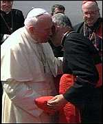 [ image: The president embraces the Pope]