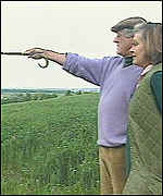 [ image: Captain Barker and his wife survey the destroyed crop]