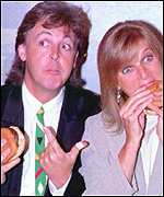 [ image: Paul and Linda enjoy a burger at the launch of the range]