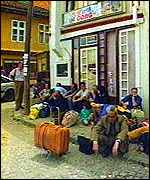 [ image: Serbs pack their bags]