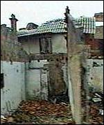 [ image: Locals say the Serbs torched their homes]