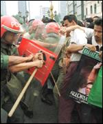 [ image: Kuala Lumpur was rocked by riots following Mr Anwar's arrest and conviction]