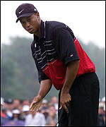 [ image: Agony for Tiger Woods as he sees another putt slip by]