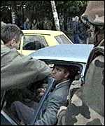 [ image: Serbs stop Albanians from entering their half of Mitrovica as a French soldier looks on]