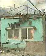 [ image: Serb homes in Mitrovica have been set on fire]