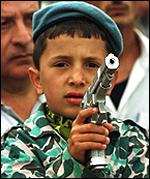 A boy with a toy gun at a protest by Turkish families of soldiers killed by Kurdish rebels