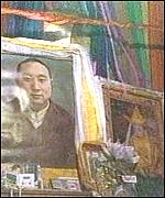 [ image: Pictures of the boy are displayed alongside those of the 10th Panchen Lama]