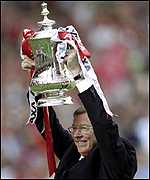 [ image: Alex Ferguson lifts the FA Cup - the second part of the historic Treble]