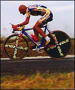 [ image: Last year's winner Marco Pantani rides a modern time trial bike]