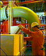 [ image: Oil rig workers produce a precious commodity]