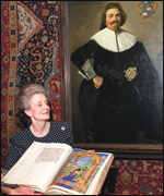 [ image: Christie's director, Elizabeth Lane, holds the early 16th century Cornaro Missal]