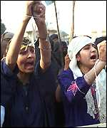 [ image: Women activists protest the Sharif-Clinton agreement]