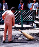 [ image: Cleaning up after street protests]