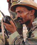 Eritrean soldier on the radio