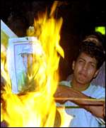 [ image: Angry reaction: Pakistanis burned posters of Wasim Akram]