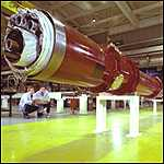 [ image: Huge magnets are needed to accelerate the particles]