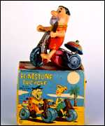[ image: Fred Flintstone on his tricycle (Value: �200-250)]