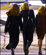 [ image: Sister Caroline (right) and cousin Maria Shriver (left) leave for the burial]