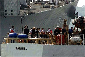 [ image: The Kennedy and Bassette families about to board the USS Briscoe from the USS Coast Guard cutter Sanibel]