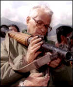 [ image: George Fernandes inspects a rocket launcher in Kargil]