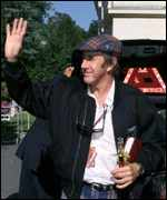 [ image: Former Formula 1 racing driver Jackie Stewart arrives at the ceremony]