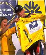 [ image: Try this for size: Armstrong is handed the famous yellow jersey]