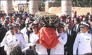 [ image: Finally, the late King's body is carried into the royal mausoleum]