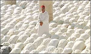[ image: Outside hundreds of Moroccans offers prayers for King Hassan]