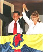 [ image: Mr Chavez and his wife wave to supporters outside the presidential palace]
