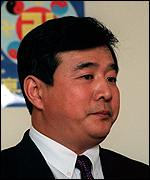 [ image: China has issued an arrest warrant for Falun Gong leader Li Hongzhi]