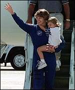 [ image: Commander Collins receives a hero's welcome with her daughter]