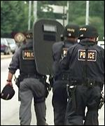 [ image: Police SWAT teams quickly arrived on the scene]