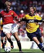 [ image: United's David Beckham holds off Emmanuel Petit's challenge in the 1998 match]