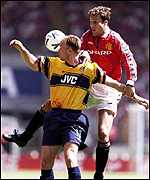 [ image: Dennis Bergkamp beats Ronny Johnsen to the ball at Wembley]
