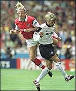 [ image: Blonde ambition: Emmanuel Petit beats United goalscorer David Beckham to the ball]
